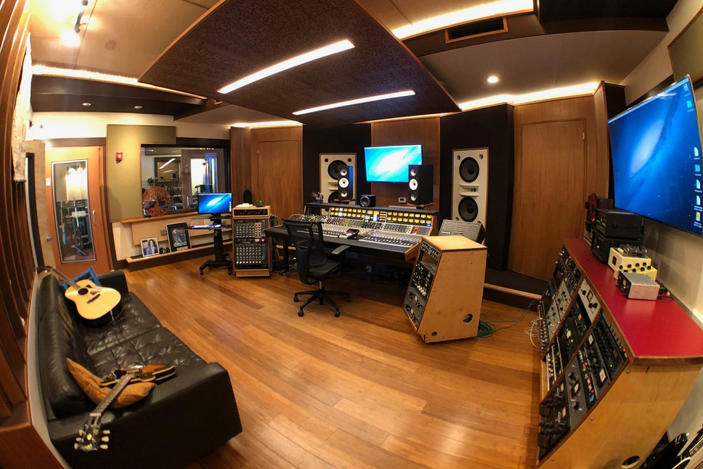 Gear guru studio owner PK Pandey Mad Oak Studios. Beautiful Control Room with Symphonic Acoustics custom speakers. WSDG was the only recording studio design firm considered for this project. Control Room right side view.