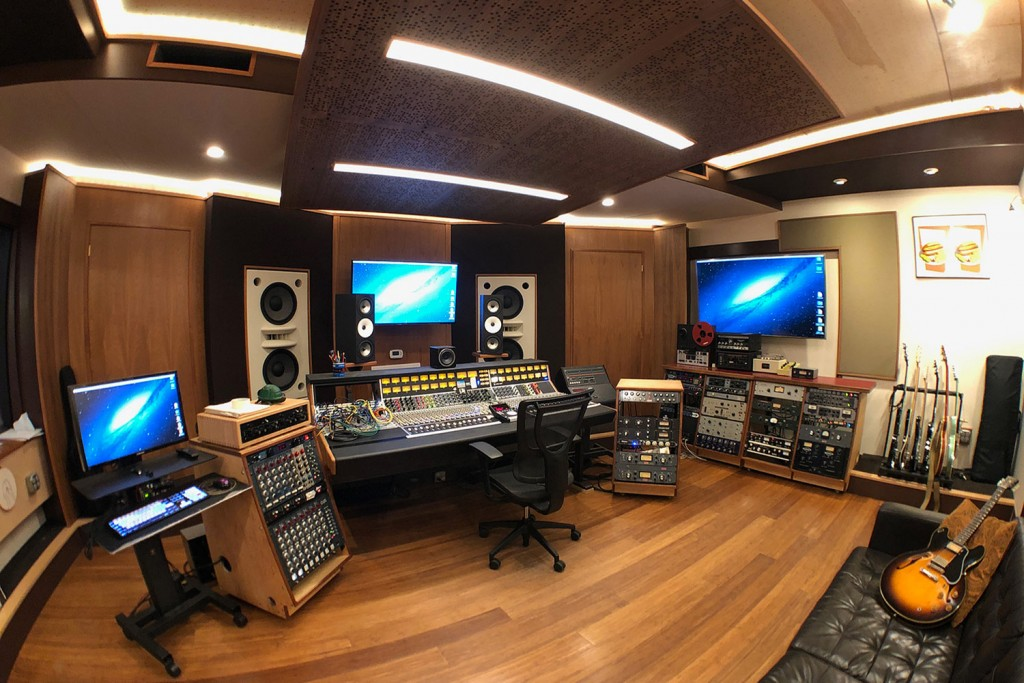 Gear guru studio owner PK Pandey Mad Oak Studios. Beautiful Control Room with Symphonic Acoustics custom speakers. WSDG was the only recording studio design firm considered for this project. Control Room left side view.