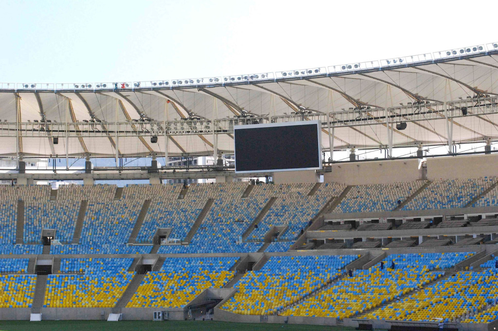 Maracana Stadium in Rio de Janeiro, Brazil. One of the biggest soccer stadiums in the world, home of the 2014 Olympic Games and World Cup. WSDG was called for consulting and installation of the audio/video of the whole facility. Long shot of the screen and seats.