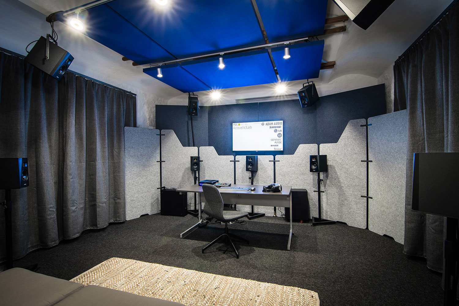 WSDG AcousticLab in Basel, Switzerland. Space designed to accurately demonstrate and reproduce different spaces auralization. Front View w Center Speaker.