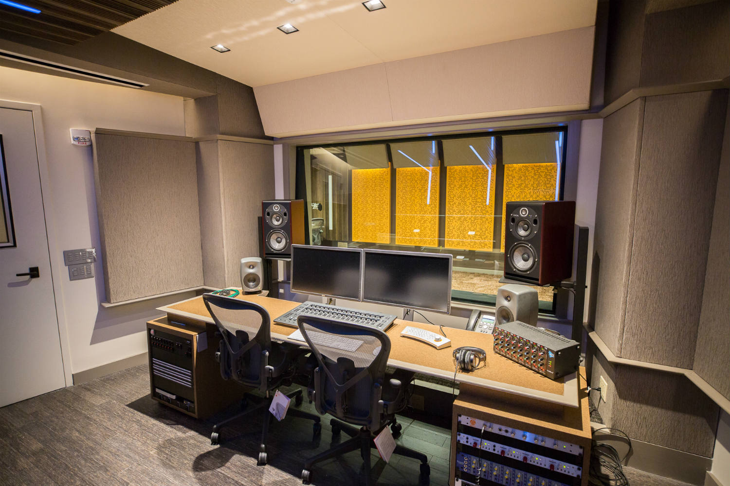 Audible is the world's largest producer/distributor of downloadable audiobooks and other spoken-word entertainment. WSDG was commissioned to design their new state-of-the-art recording studio complex. Control Room A back view