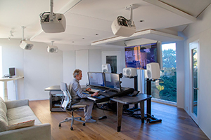 World-renown composer for films Carter Burwell returned to John Storyk and commissioned WSDG a new recording studio at his ultra modern Maziar Behrooz-designed home. Carter at his WSDG-designed studio working, side view.