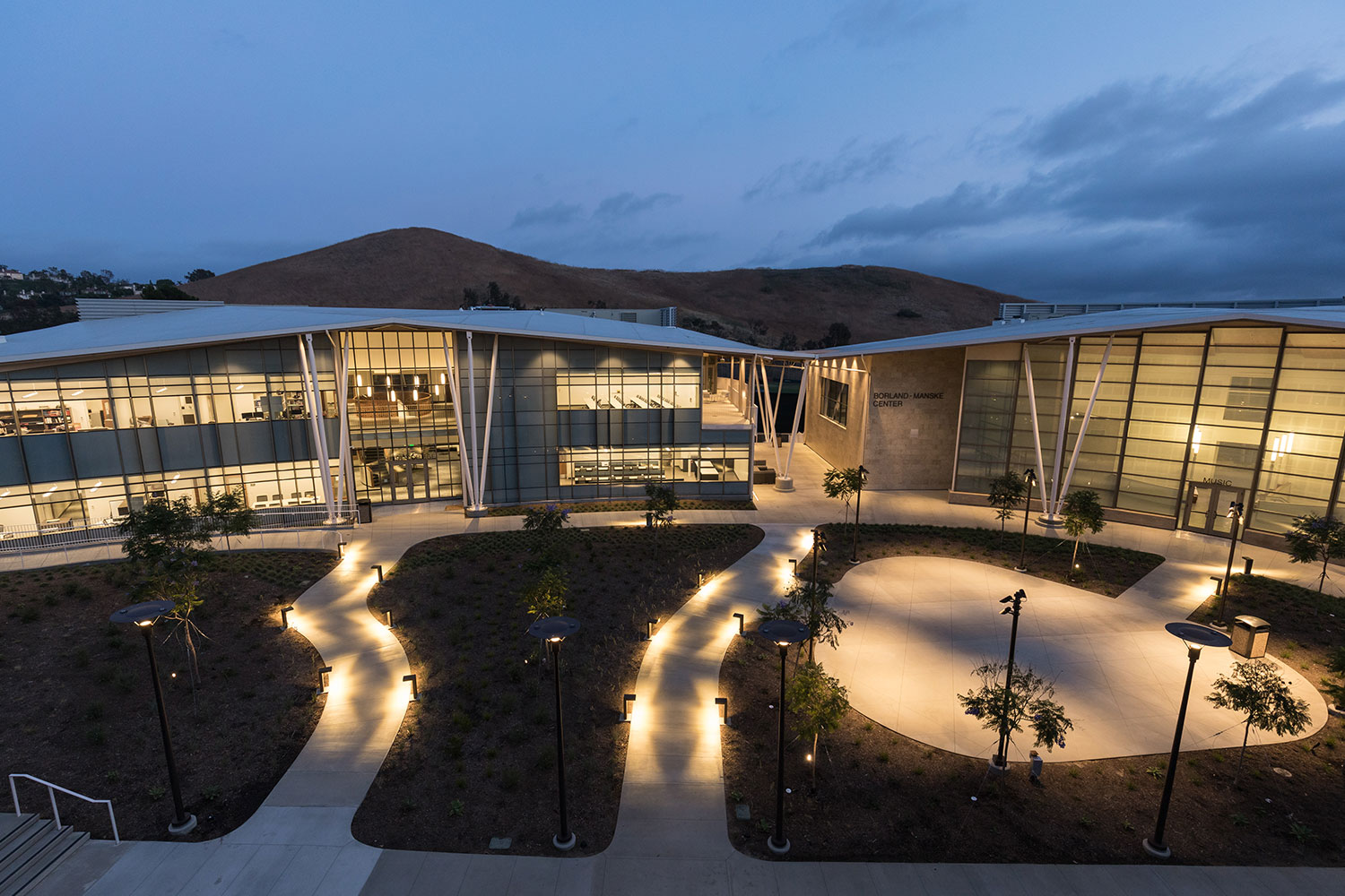 Concordia University Irvine, WSDG was commissioned for the design, acoustic consulting and systems integration of their new audio complex. Exterior at night.
