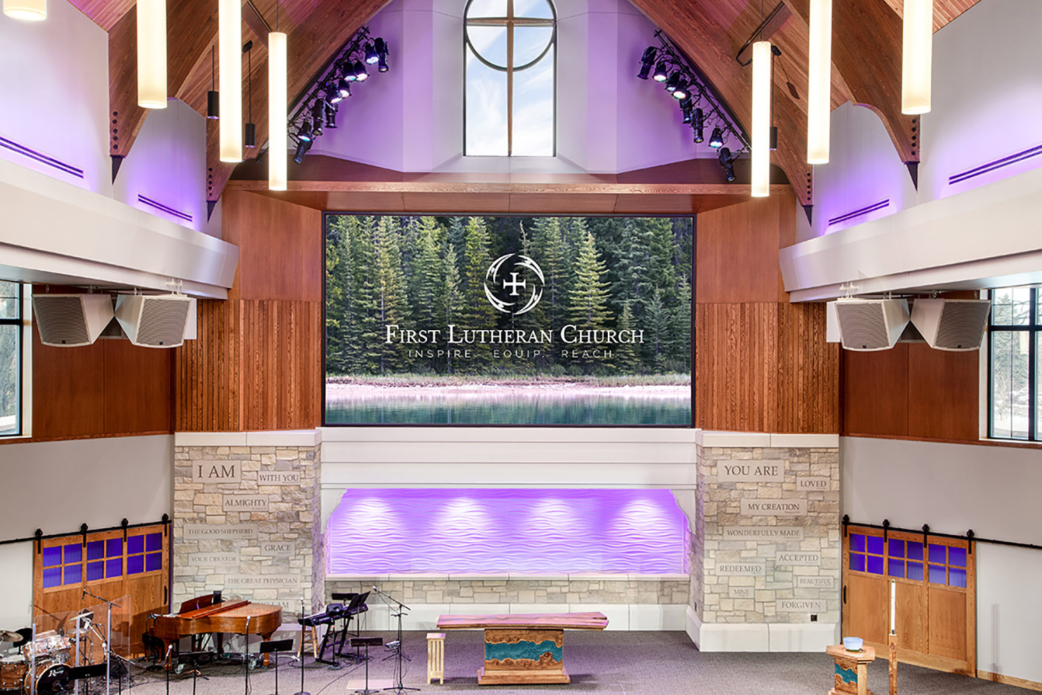 The First Lutheran Church of Fargo, ND engaged WSDG to develop an acoustic and sound isolation program for their newly constructed Celebration Center. Stage View.