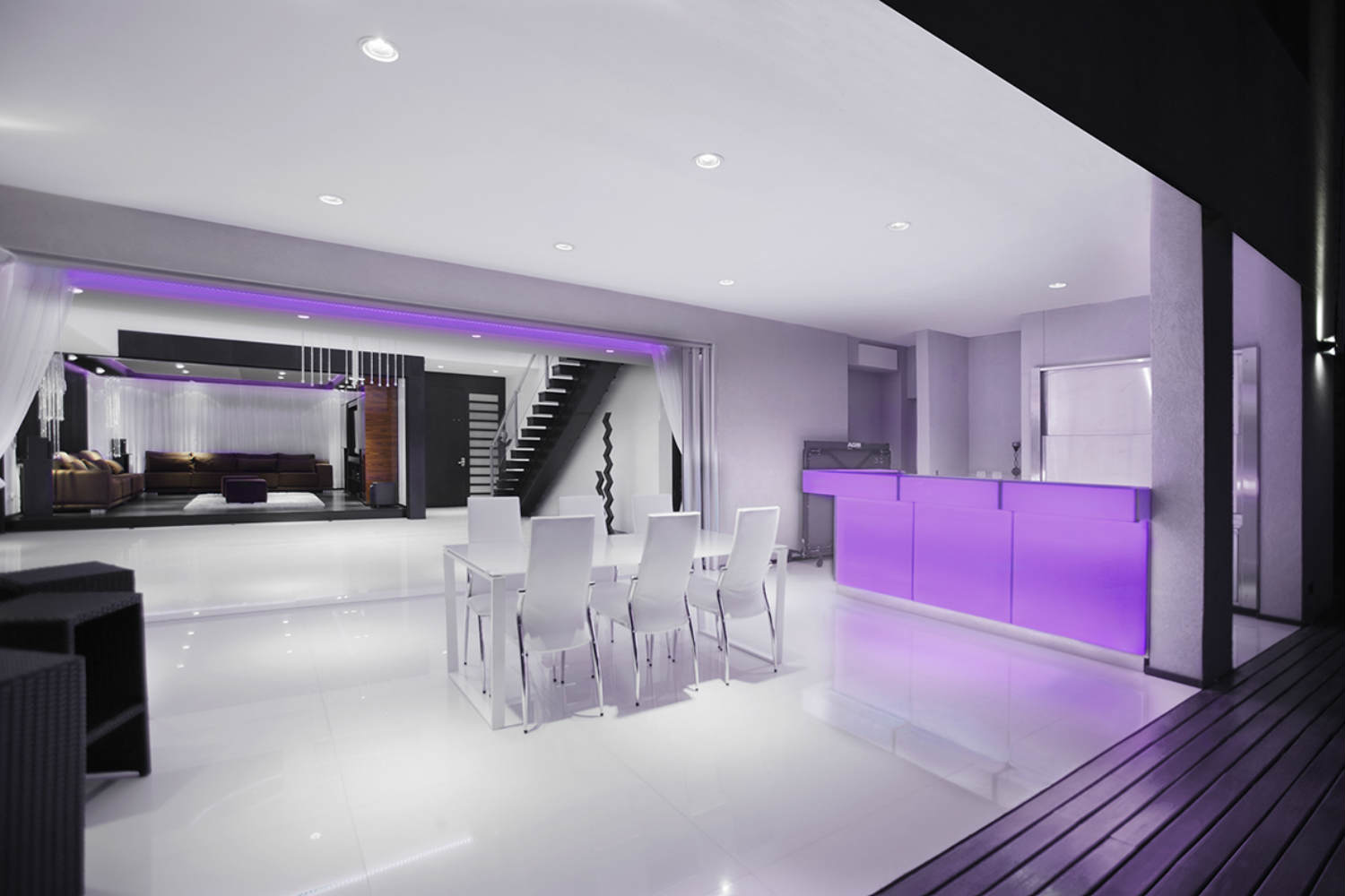 Casa Fontela in Buenos Aires, Argentina designed by WSDG. Dining room changes color with integrated invisible indirect LED lighting.