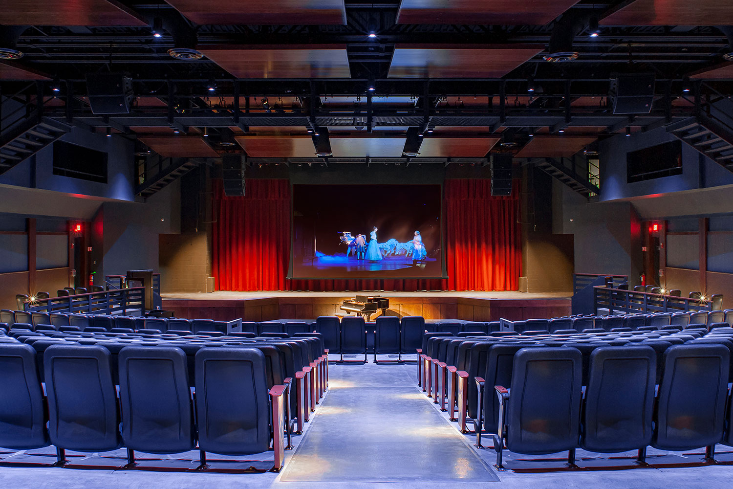 Goshen High School new auditorium in Goshen, NY. WSDG was retained to acoustically measure the space and collaborate on the redesign with LAN Associates to optimize the space for these needs while still retaining the aesthetic goals of the redesign. Front View.