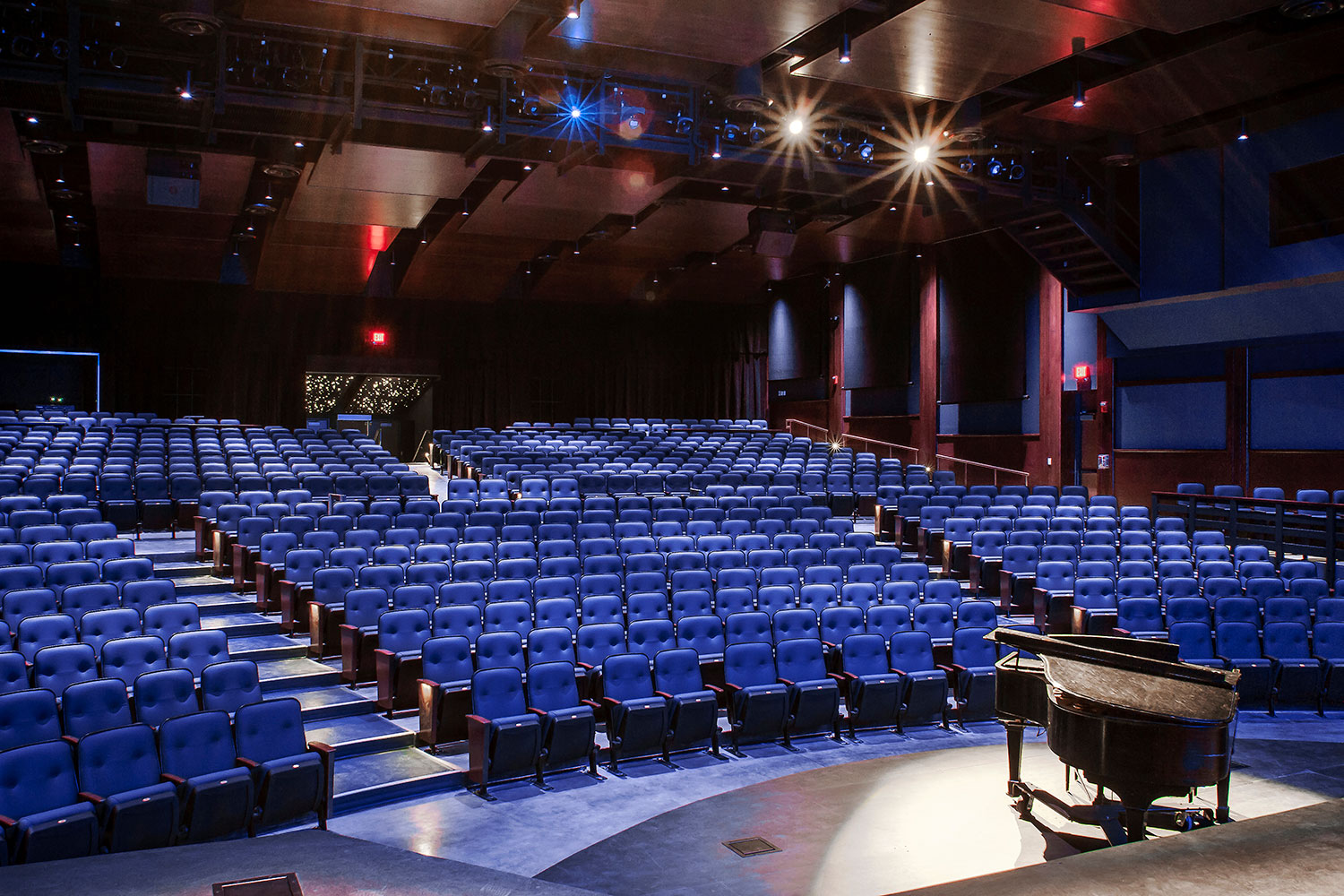 Goshen High School new auditorium in Goshen, NY. WSDG was retained to acoustically measure the space and collaborate on the redesign with LAN Associates to optimize the space for these needs while still retaining the aesthetic goals of the redesign. Stage View.