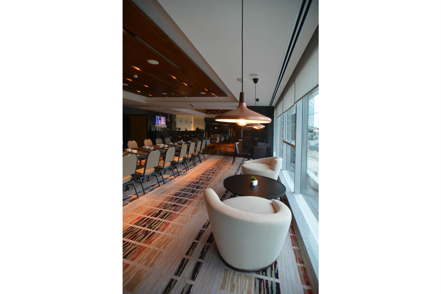 Hilton Garden Inn in Montevideo, Uruguay. Invisible acoustics designed and install by WSDG - WSDG Latin, Sergio Molho and Silvia Molho. Bar window seat