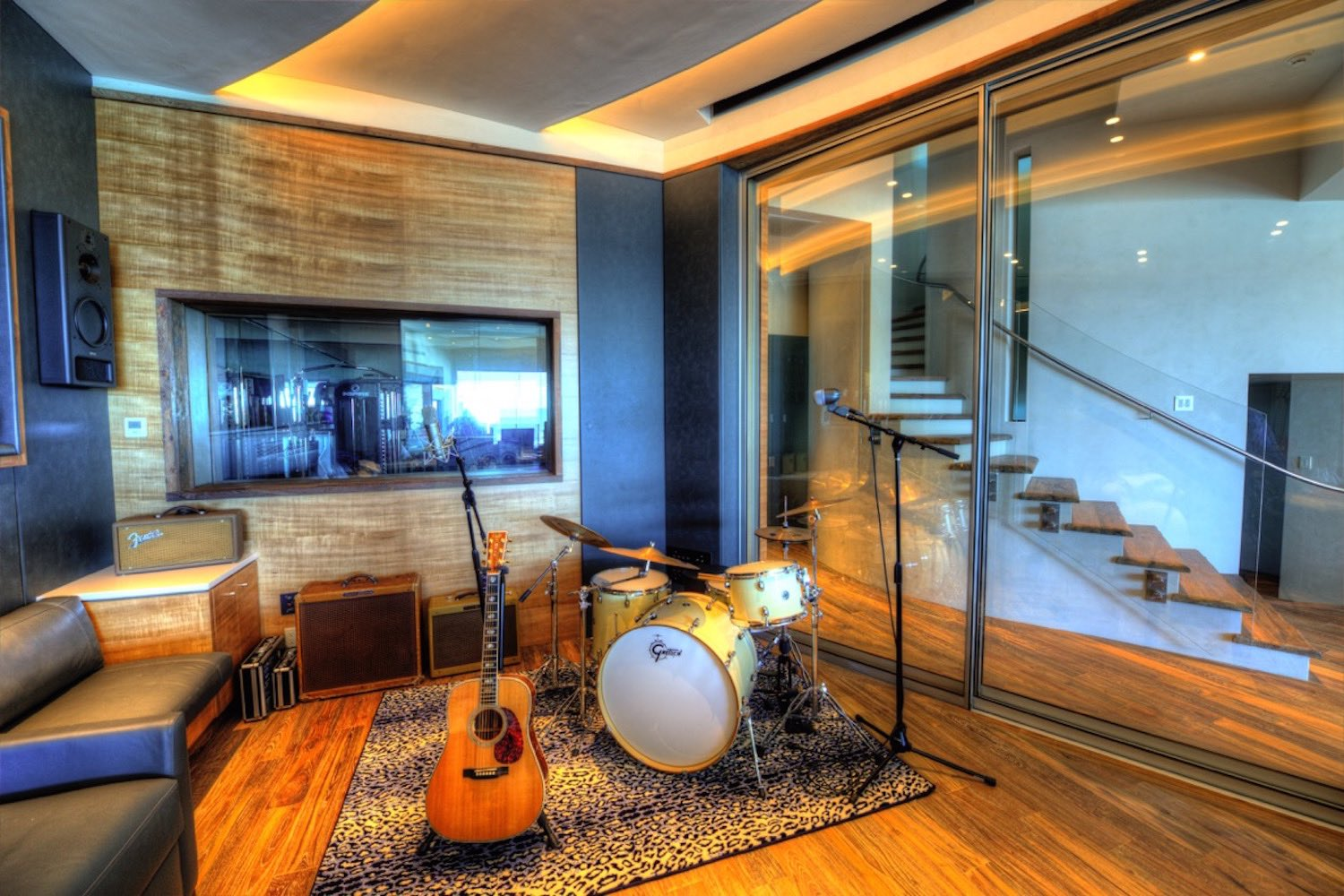 Chris Huber commissioned WSDG to design his residential private ocean-view recording studio inspired in their glass design in Diante Do Trono. Studio back with drums.
