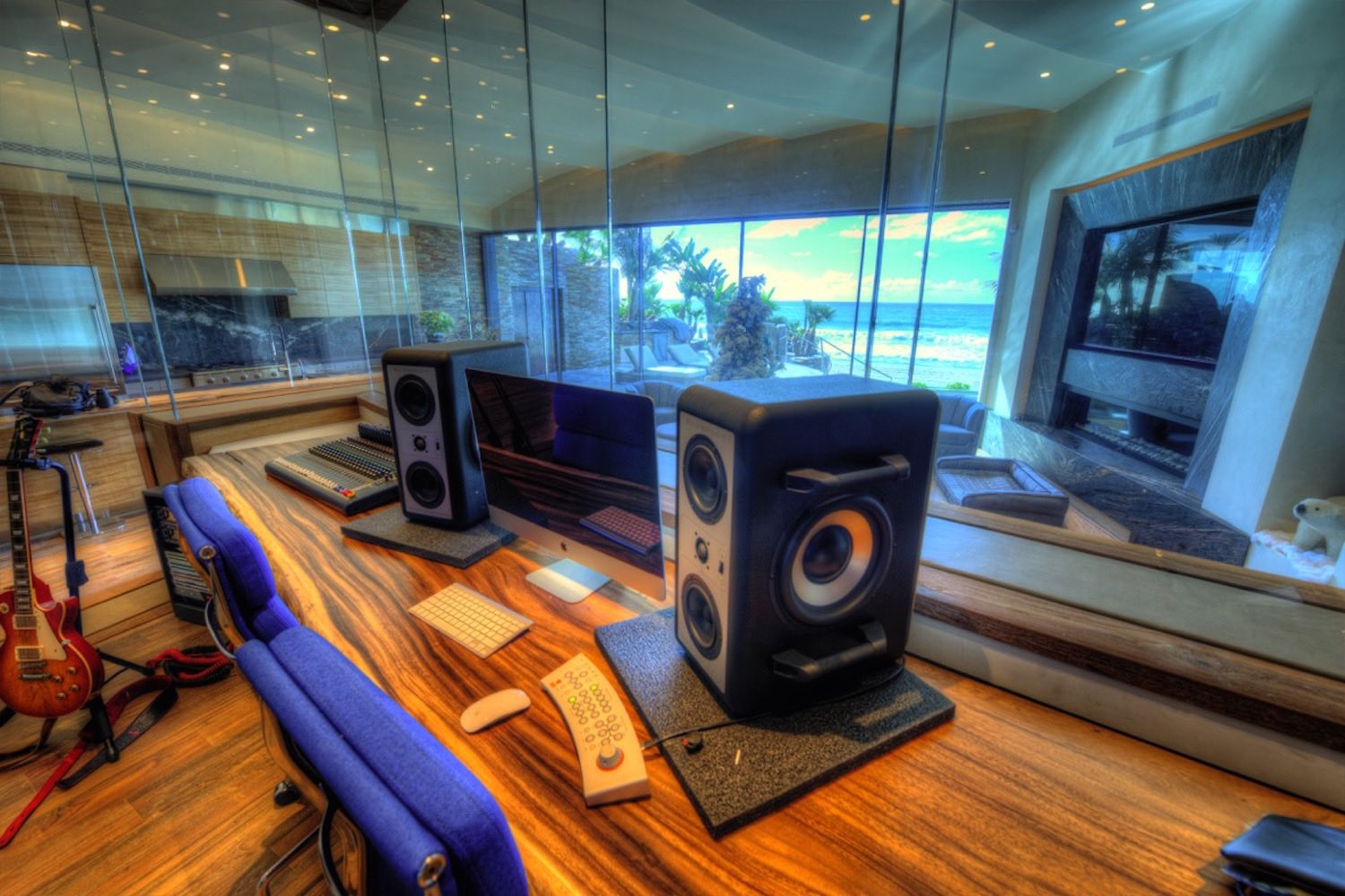 Chris Huber commissioned WSDG to design his residential private ocean-view recording studio inspired in their glass design in Diante Do Trono. Studio Barefoot speakers.