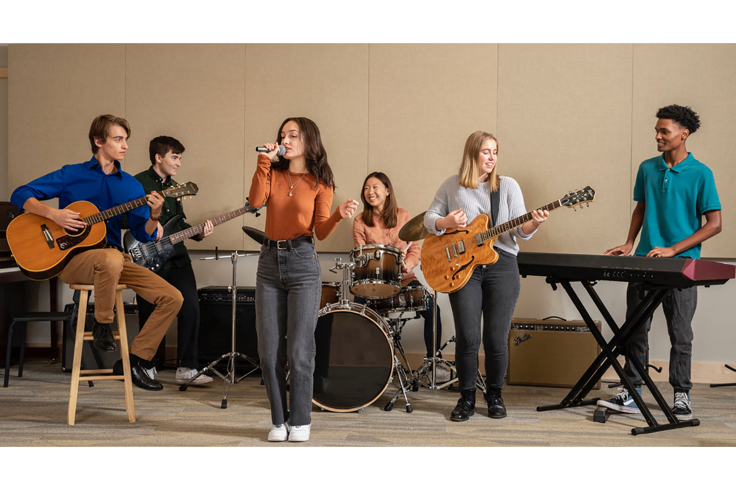 Interlochen has recently completed their new complex. A key component of the new complex is a state-of-the-art recording/teaching studio complex developed by WSDG. Students band playing.