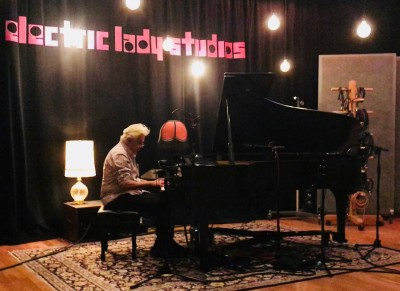 John Storyk playing a grand piano at the legendary Jimi Hendrix' Electric Lady Studios. The first studio he and WSDG designed back in 1969.