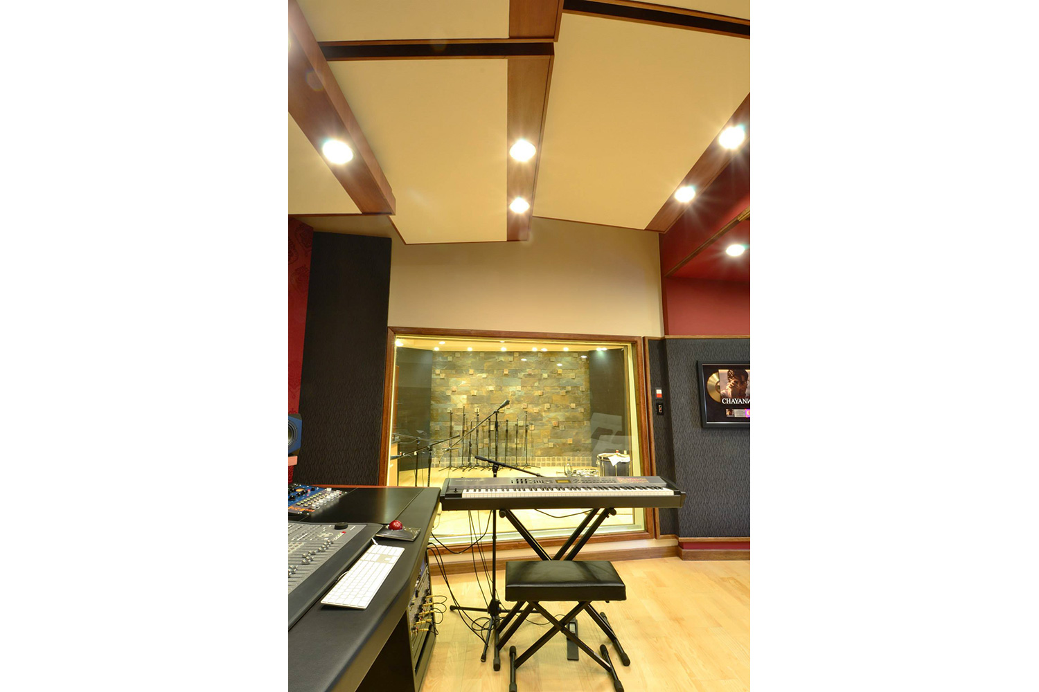Jose Gentile home recording studio designed by WSDG in Cordoba, Argentina. Control room glass side wall.