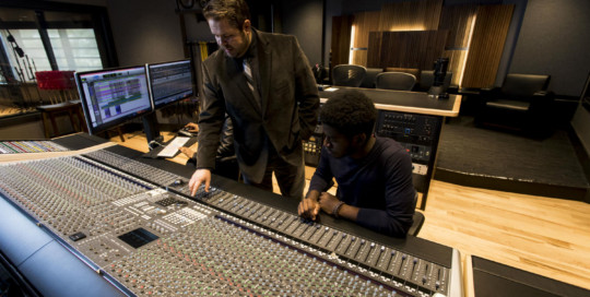 WSDG has designed a state-of-the art recording /teaching studio for the expanding campus of Liberty University, America's largest private, non-profit Christian university.Control Room with Faculty and Student.
