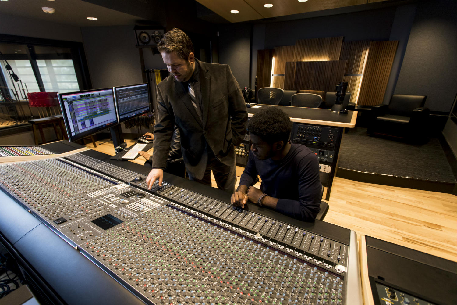 WSDG has designed a state-of-the art recording /teaching studio for the expanding campus of Liberty University, America's largest private, non-profit Christian university. Control Room with Faculty and Student.