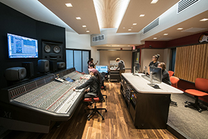 Montgomery County Community College in Blue Bell, PA brand-new Recording Studio for their Digital Music Technology course. Designed by WSDG. Architectural acoustics and media systems engineering. Control Room with MCCC students.