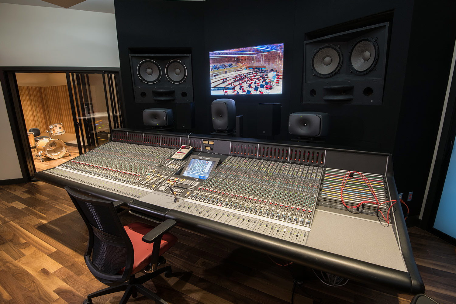 Montgomery County Community College in Blue Bell, PA brand-new Recording Studio for their Digital Music Technology course. Designed by WSDG. Architectural acoustics and media systems engineering. Control Room From View of SSL XL board and Augspurger Speakers.
