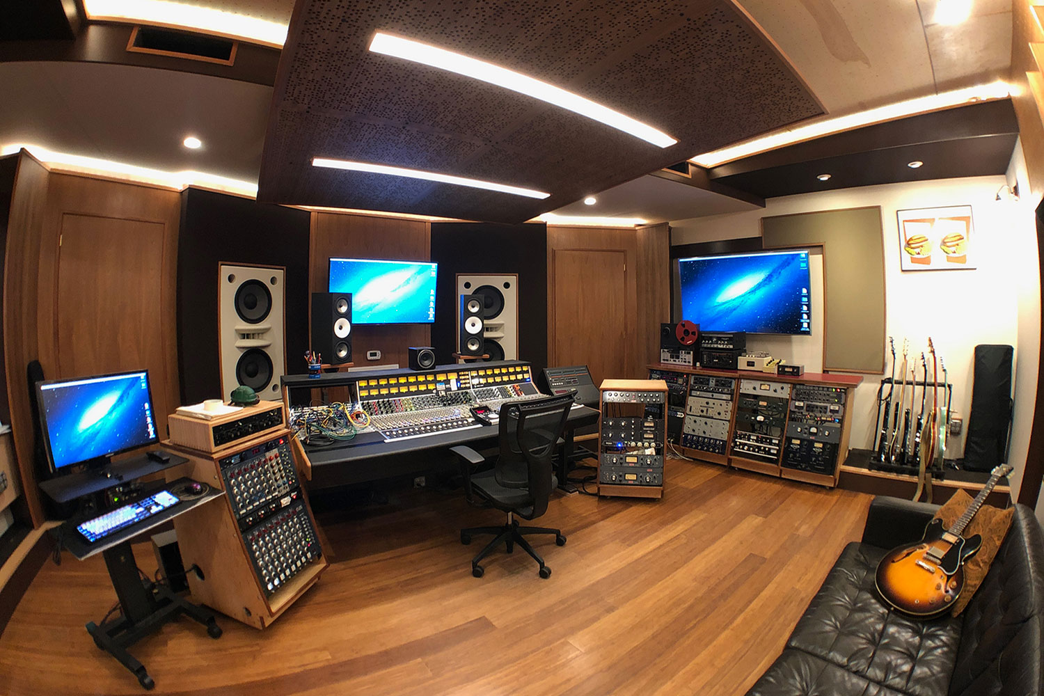 Gear guru studio owner PK Pandey Mad Oak Studios. Beautiful Control Room with Symphonic Acoustics custom speakers. WSDG was the only recording studio design firm considered for this project. Control Room left side view 2.