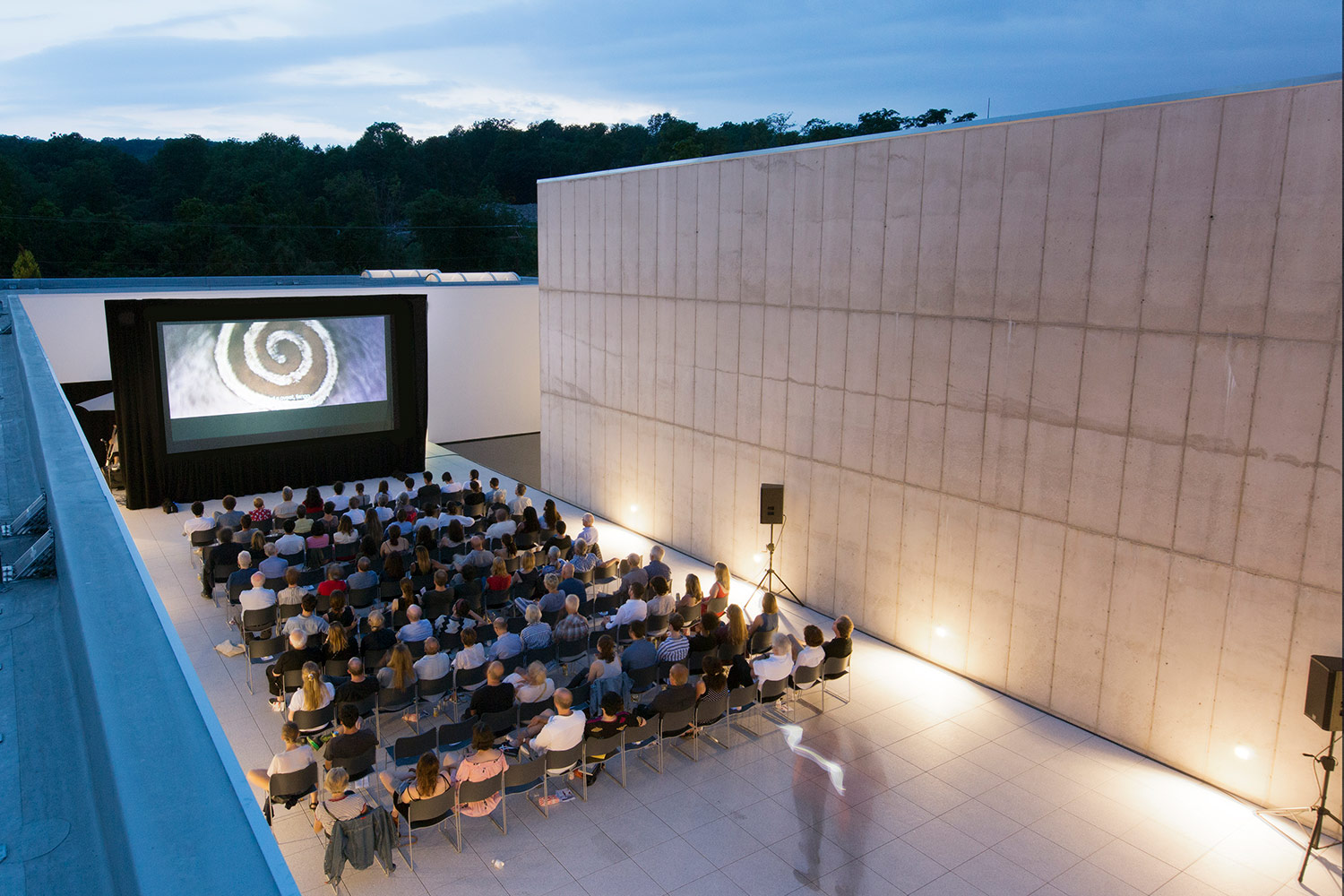 Art-collectors Nancy Olnick and Giorgio Spanu needed expert acousticians for their Magazzino Italian Art collection museum screenings in NY, they engaged WSDG to recommend and integrate a comprehensive equipment package. Roof Viewing to Cinema 2.