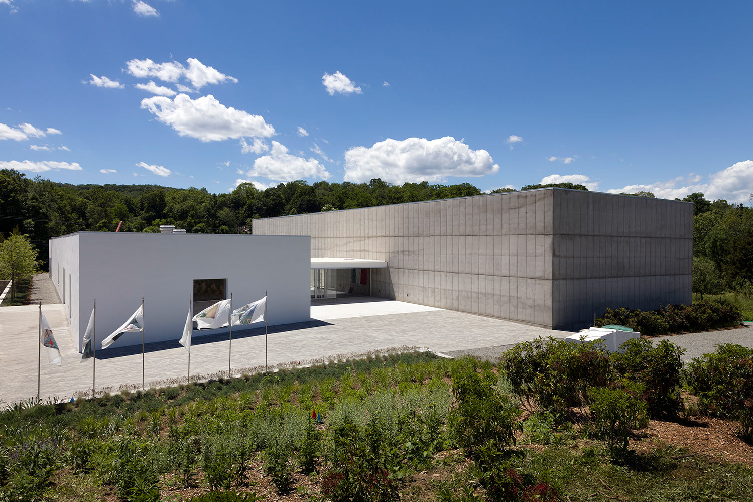 Art-collectors Nancy Olnick and Giorgio Spanu needed expert acousticians for their Magazzino Italian Art collection museum screenings in NY, they engaged WSDG to recommend and integrate a comprehensive equipment package. Exterior.
