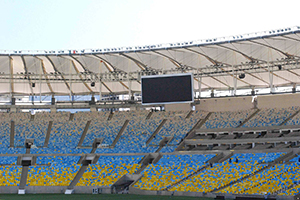 Maracana Stadium in Rio de Janeiro, Brazil. One of the biggest soccer stadiums in the world, home of the 2014 Olympic Games and World Cup. WSDG was called for consulting and installation of the audio/video of the whole facility. Long shot of the screen and seats. Long shot with screen and seats.