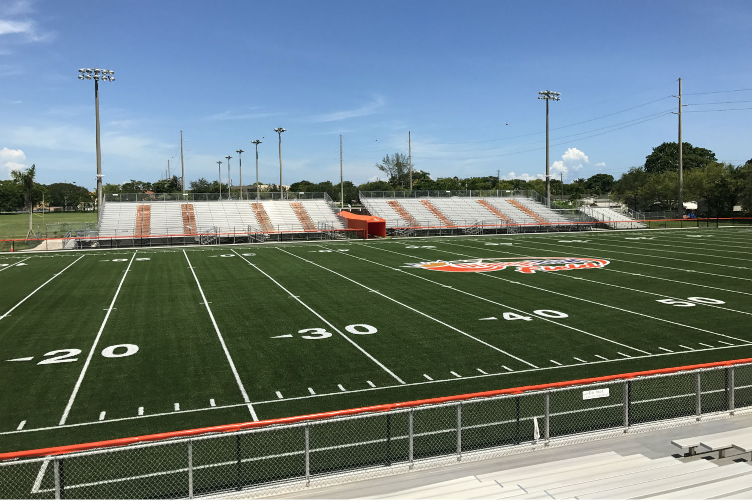 The Orange Bowl Field at Harris Field Park is the Orange Bowl's fourth Legacy Gift to the South Florida community. WSDG was reached by Groovyland Corp to design the sound system design and systems integration for the field's rejuvenation. Field at daylight.