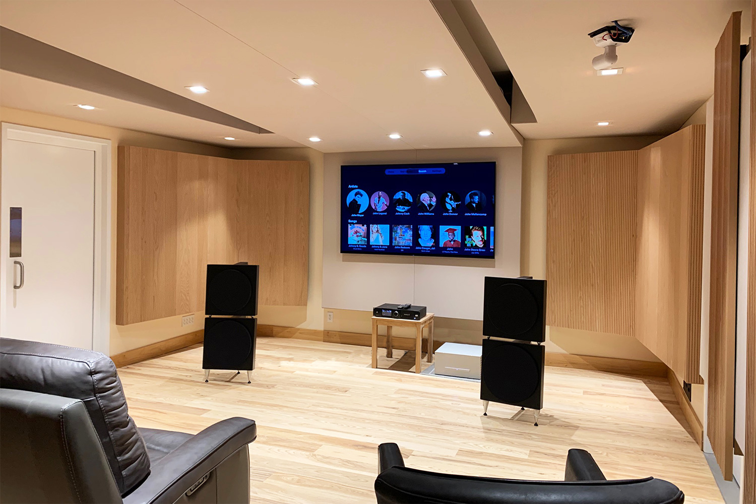 Luxury minimalistic audiophile listening room in a private residence in upstate New York. Acoustic isolation and A/V Systems design by WSDG. Listening Room front.