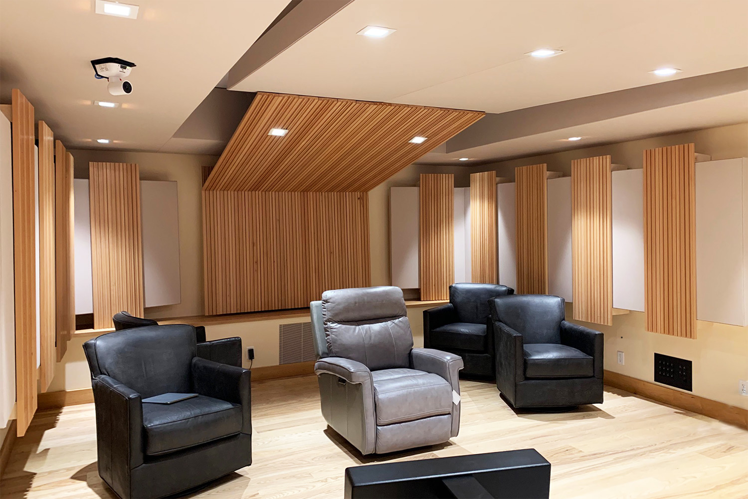 Luxury minimalistic audiophile listening room in a private residence in upstate New York. Acoustic isolation and A/V Systems design by WSDG. Listening Room back.