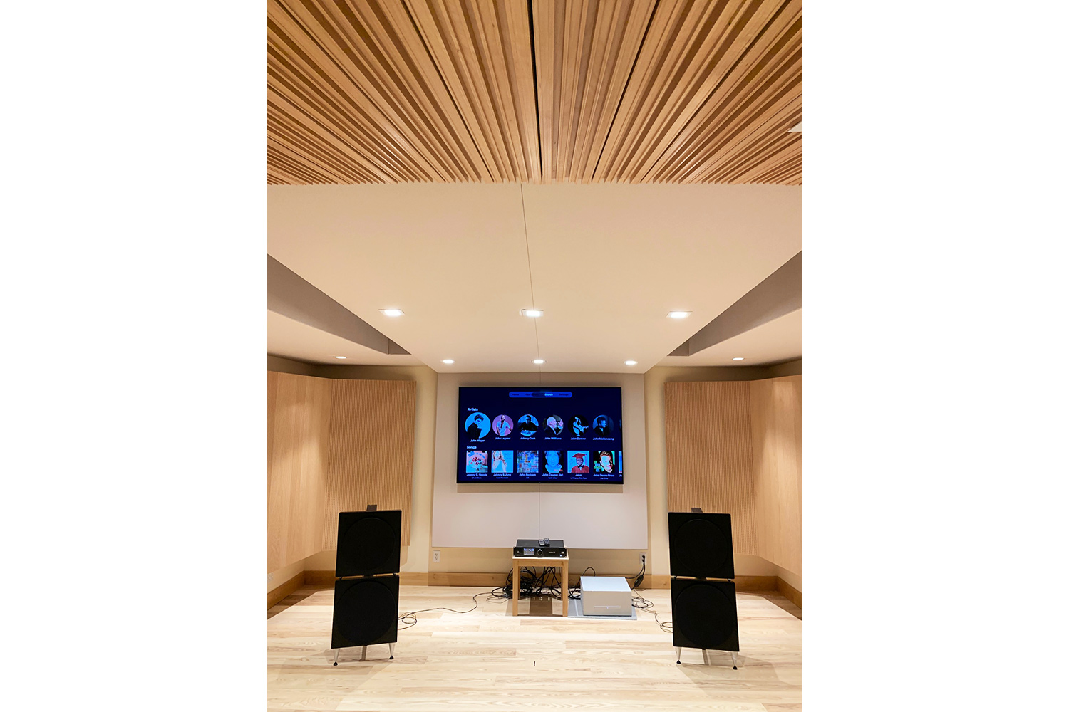 Luxury minimalistic audiophile listening room in a private residence in upstate New York. Acoustic isolation and A/V Systems design by WSDG. Listening Room vertical front.