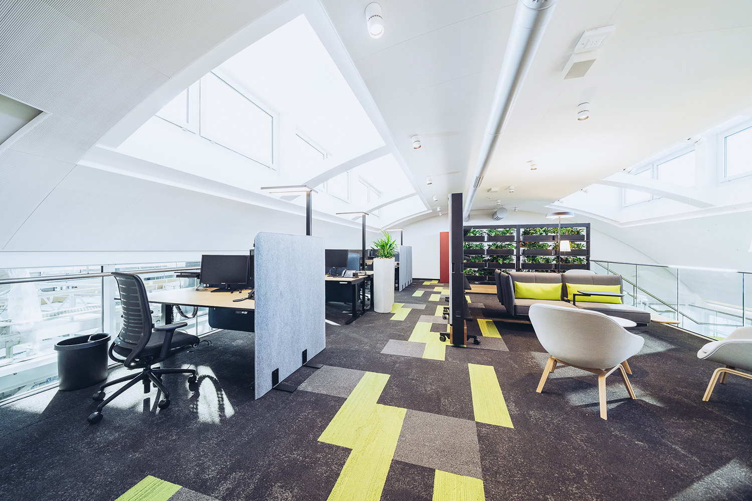SWICA, one of Switzerland's leading healthcare and insurance organizations, retained WSDG to create an efficient and acoustically pleasant open space environment. Back View.