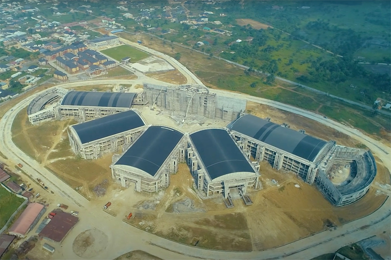 "Bishop David Oyedepo Salvation Ministries ""Hand of God"". WSDG brought to supervise the acoustic design and design professional audio and video production facilities for the worship center. Aerial view in construction."