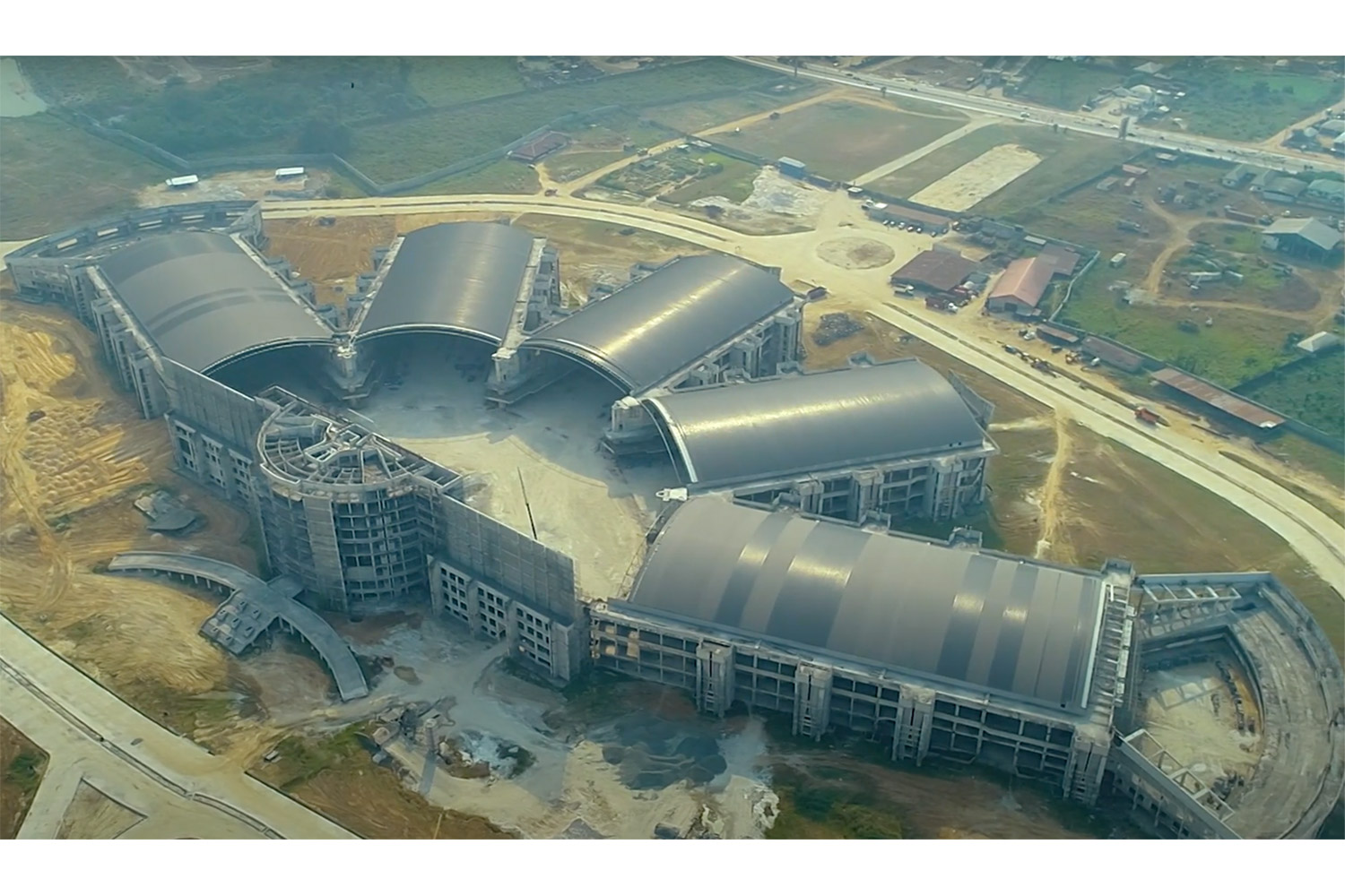 "Bishop David Oyedepo Salvation Ministries ""Hand of God"". WSDG brought to supervise the acoustic design and design professional audio and video production facilities for the worship center. Aerial view."