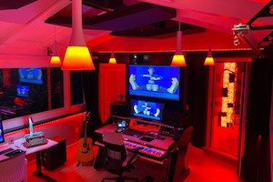 Multi-talented Scooter Pietsch conceived a professionally designed CR/Recording/Mixing room and retained WSDG to design his new studio. Control Room red.