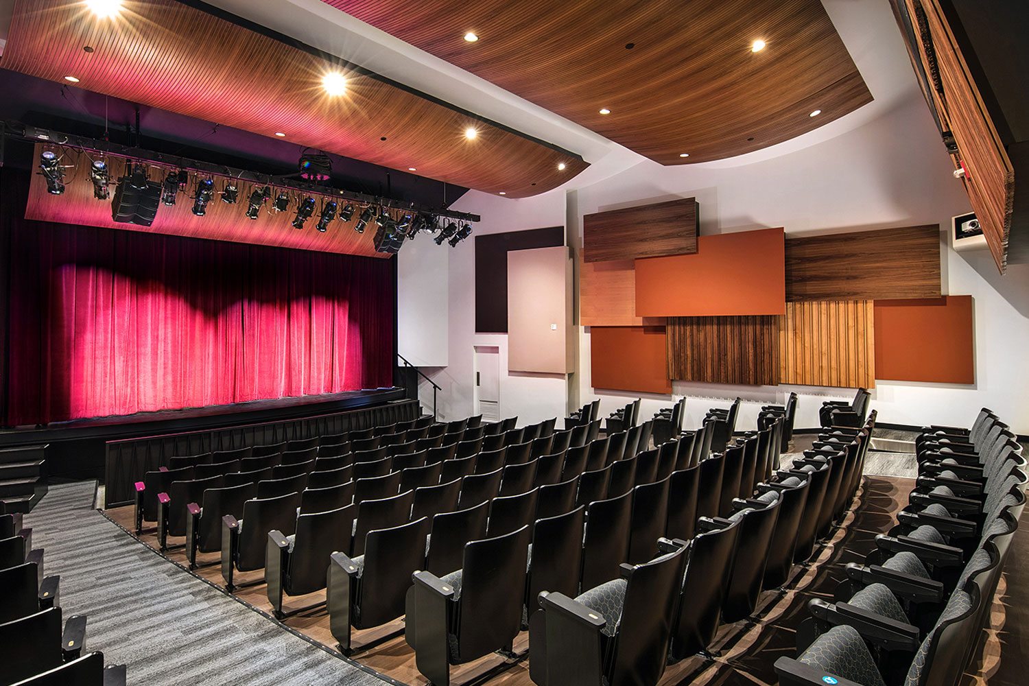 The Herb Alpert Foundation engaged WSDG to design the acoustics for a small on-campus live performance theater at the prestigious UCLA, with help of Lani Hall. Theater side view with red curtain.
