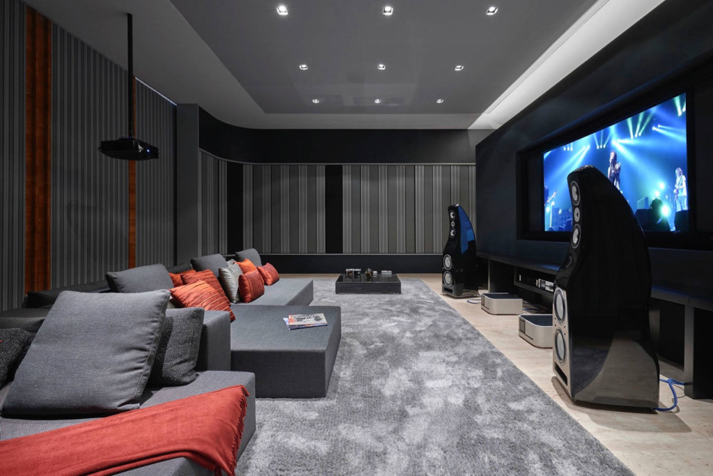 This ultra luxurious home in Belo Horizonte, Brazil had two primary requirements: The quintessence of advanced audio and video technology, and it was to be housed in the most sumptuous and acoustically pristine environment imaginable. Home Theater side photo. WSDG Residential projects.