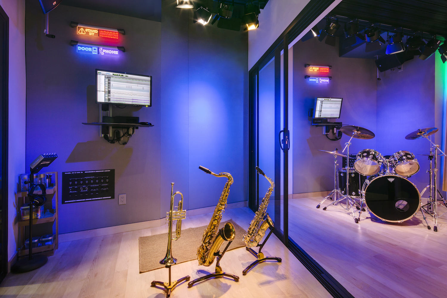 The MacPhails met WSDG to achieve a full up, professionally designed, acoustically superlative residential recording studio for their thriving audio production business. ISO Booth with sax and drums.