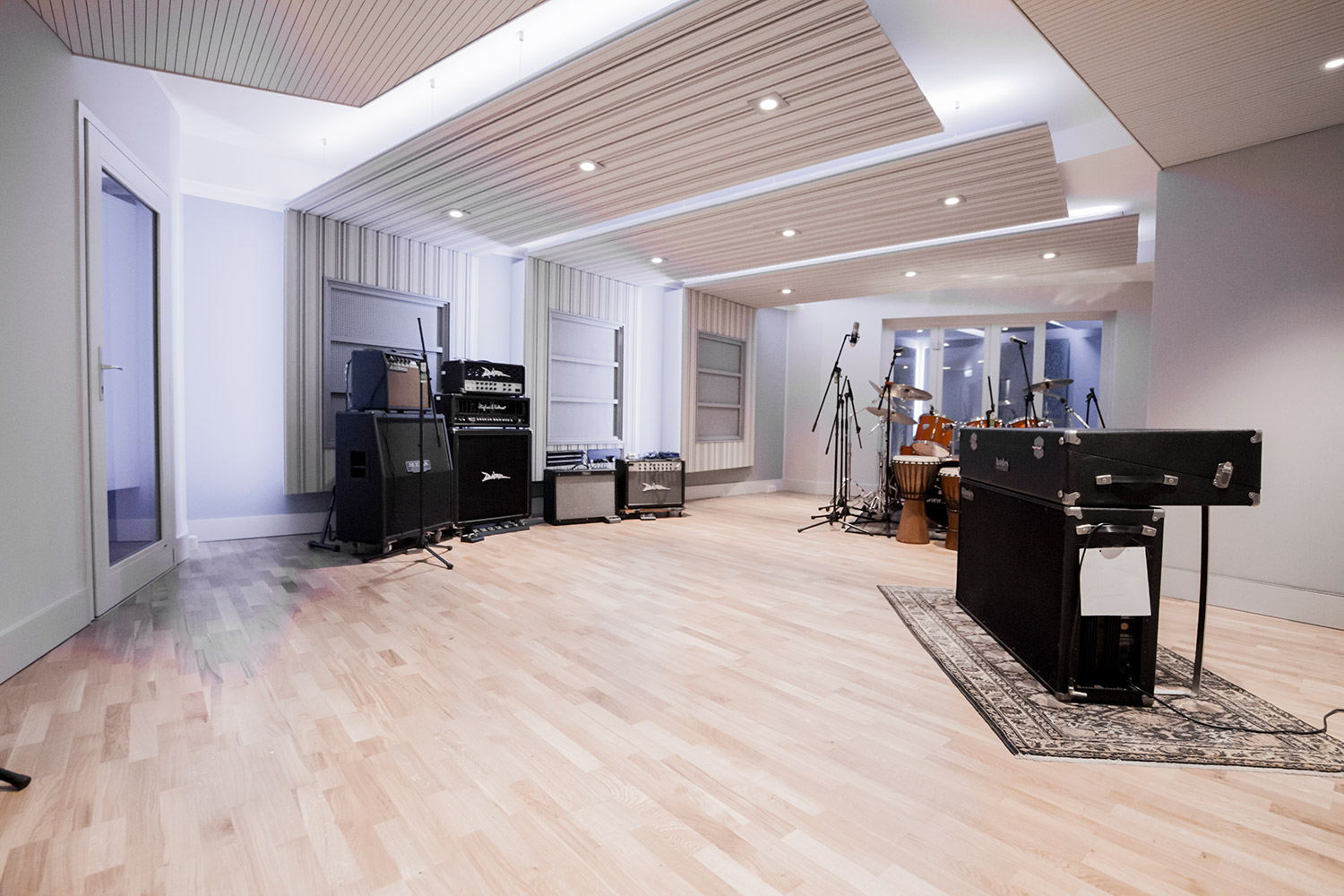 Vienna City Sound is a twelve-room recording studio built in the basement of a vintage commercial building in the heart of Vienna. Owner Peter Zimmerl's retained the services of WSDG to design his dream studio. Live room wide photo.